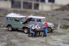 Miniature people of drinking tea on break time. Taking time for conversation and with hot beverage stock image