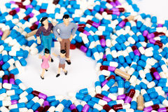 Miniature people with drug capsule Stock Photography