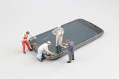 Miniature people in engineer or worker occupation Royalty Free Stock Image