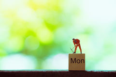 Miniature people,engineer working on wooden Royalty Free Stock Image