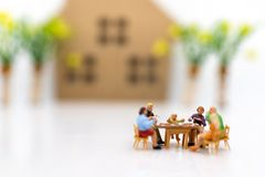 Miniature people: Families are celebrating , eating together happily. Image use for the concept of family festival.  royalty free stock photography
