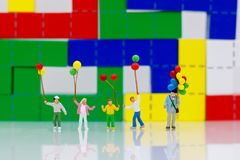 Miniature people, family and children enjoy with colorful balloons, happy family day concept. stock photos