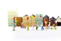 Miniature people, family and children enjoy with colorful balloon. S, happy family day concept royalty free stock photo