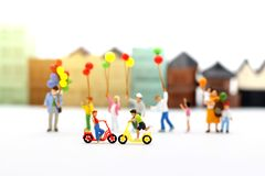 Miniature people, family and children enjoy with colorful balloon. S, happy family day concept royalty free stock photography