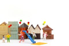 Miniature people, family and children enjoy with colorful balloon. S, happy family day concept stock image