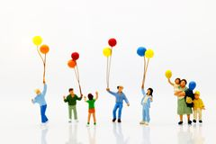 Miniature people, family and children enjoy with colorful balloo. Ns, happy family day concept Royalty Free Stock Photos