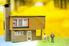 Miniature people : Family and children with house using for concept of step family day. royalty free stock photography