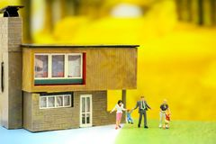Miniature people : Family and children with house using for concept of step family day. stock photography