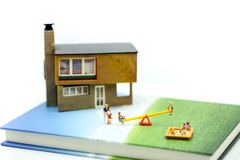 Miniature people : Family and children with house using for concept of step family day. royalty free stock images