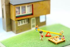 Miniature people : Family and children with house using for concept of step family day. stock image