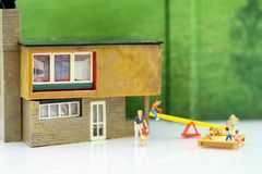 Miniature people : Family and children with house using for concept of step family day. stock photos
