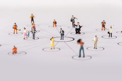 Miniature people family in diagrams Stock Photos