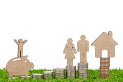 Miniature People Family with Stack Coins. On grass floor.selective focus Royalty Free Stock Images