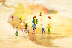 Miniature people: Family stand on map of world. Image use for background International day of families concept.  stock photos