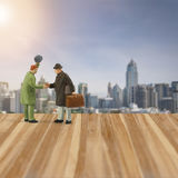 Miniature people figure ,handshake with friend in meeting point Royalty Free Stock Image