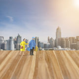 Miniature people figure, Honey moon in the city. Miniature people figure ,Husband and wife tourist walking on honey moon time , wooden floor and city background Royalty Free Stock Photography