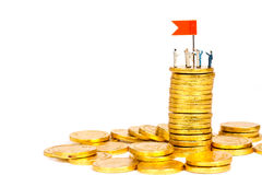 Miniature people with gold coin Royalty Free Stock Photography