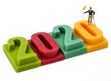Miniature people: Golfer stand on number of Happy new year and Christmas 2020 background
