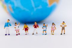 Miniature people : Group children standing with world map. Image use for study international, back to school concept.  Stock Images