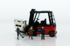 Miniature people : Group people auto insurance when an accident on the road. Image use for Make an agreement, responsibility. Business concept Royalty Free Stock Images