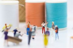 Miniature people: Group Women weaving factory protest. Image use for Claims or benefits should be earned from hard work.  Stock Images
