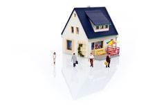 Miniature people with house Stock Photography