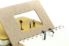 Miniature people : journalists , cameraman ,Videographer at work royalty free stock photos