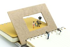 Miniature people : journalists , cameraman ,Videographer at work. Shooting on Shoppers with discount for shopping items of market street,Business Shopping Royalty Free Stock Photo