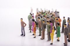 Miniature people line with boss. Miniature people line with boss over white background Royalty Free Stock Photos