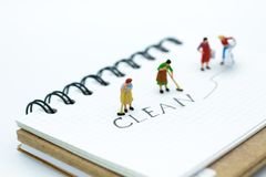 Miniature people : Maid cleaning with `clean` text. Image use cleaning day stock image