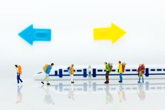 Miniature people: Many Travellers traveing by train at train station. Image use for Travel business concept Stock Photo