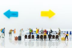 Miniature people: Many Travellers traveing by train at train station. Image use for Travel business concept Royalty Free Stock Photo