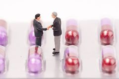 Miniature people and medical drug Stock Images