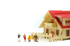 Miniature people : meet with realtor or broker talking about home purchase,taking loan for first apartment, family counselling.  stock photo