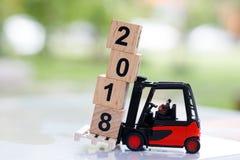 Miniature people move block number 2018. Stock Photos