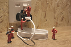 Miniature people Network Engineers At Work Stock Photography