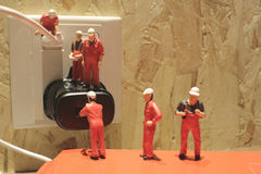 Miniature people Network Engineers At Work Royalty Free Stock Photos