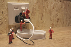 Miniature people Network Engineers At Work Stock Photos