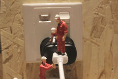 Miniature people Network Engineers At Work Royalty Free Stock Photography