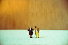 Miniature people, old couple businessman Royalty Free Stock Image