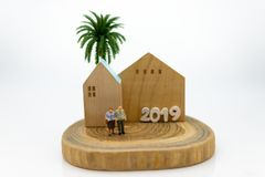 Miniature people, Old couple figure with home. Image use for background retirement planning, Life insurance concept. Miniature people, Old couple figure with royalty free stock images