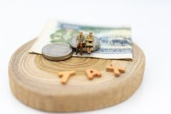 Miniature people, Old couple figure sitting on top of stack coins using as background retirement planning, Life insurance concept. Miniature people, Old couple stock images