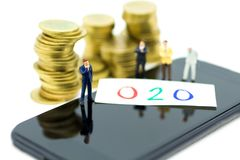Miniature people: Old people standing on top of stack coins . Image use for background retirement planning, Life insurance concept.  Stock Images