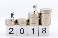 Miniature people: Old people standing on top of stack coins . Image use for background retirement planning, Life insurance concept.  Stock Photos