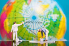 Miniature people : Painters painting on The globe  background. Earth day concept Stock Image