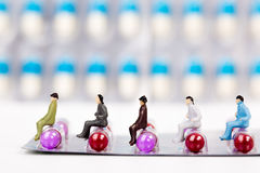 Miniature people with panel of drug Royalty Free Stock Photography