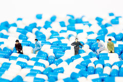 Miniature people with panel of drug Royalty Free Stock Photos