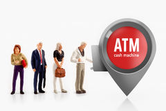 Miniature people  - people stand in front a ATM machine Royalty Free Stock Photography