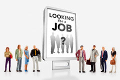 Miniature people  - people standing in front of a job recruitment billboard Stock Images