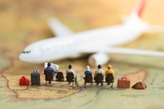 Miniature people : people waiting for plane using as background. Travel, business trip traveler adviser agency or transportation concept Stock Photos